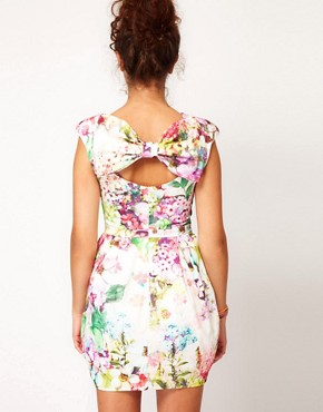Image 1 ofRiver Island Cocoon Skirted Dress With Bow Back