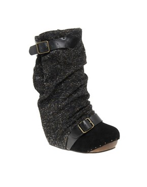 Irregular Choice Long Lashes Tweed Concealed Wedge Boots from us.asos.com